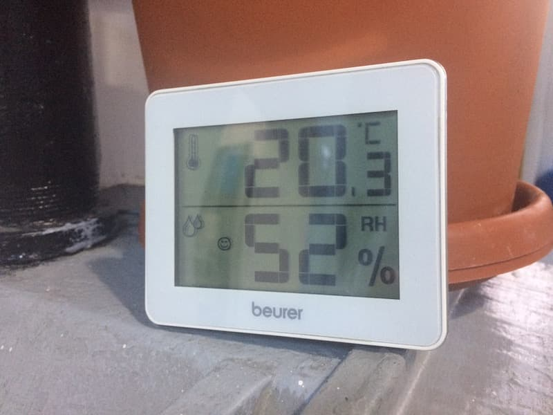 A digital hygrometer showing around 50% relative humidity