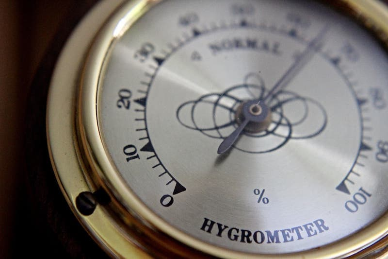 Hygrometer showing a high humidity of 65 percent